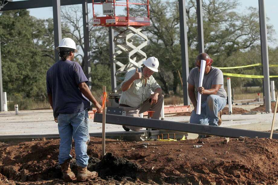 Teal Construction Co. senior superintendent Mike Estes, center, supervises his crew at the construction site of a new terminal at Texas Gulf Coast Regional Airport.Teal Construction Co. senior superintendent Mike Estes, center, supervises his crew at the construction site of a new terminal at Texas Gulf Coast Regional Airport. Photo: Pin Lim, Freelance / Copyright Pin Lim.