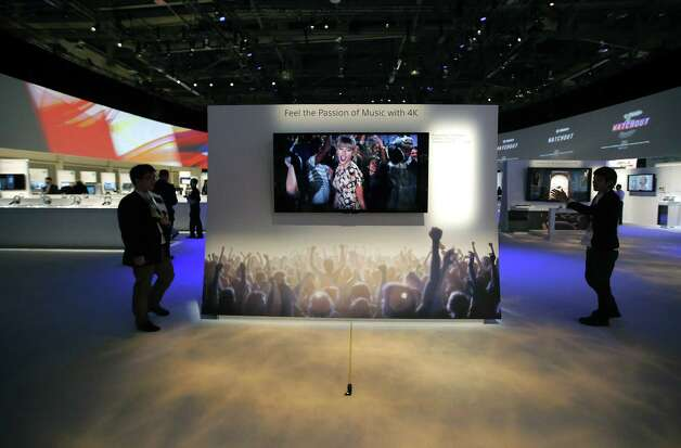Technicians install Sony's 4k Ultra HD television at the Sony booth at the International Consumer Electronics Show in Las Vegas, Monday, Jan. 7, 2013. The 2013 International CES gadget show, the biggest trade show in the Americas, is taking place in Las Vegas this week. (AP Photo/Jae C. Hong) Photo: Jae C. Hong, Associated Press / AP
