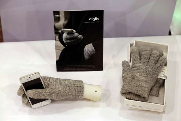 LAS VEGAS, NV - JANUARY 07:  Moshi Digits touchscreen gloves are displayed during the 2013 International CES Digital Experience media preview at the MGM Grand Conference Center on January 7, 2013 in Las Vegas, Nevada. CES, the world's largest annual consumer technology trade show, runs from January 8-11 and is expected to feature 3,100 exhibitors showing off their latest products and services to about 150,000 attendees. Photo: Justin Sullivan, Getty Images / 2013 Getty Images