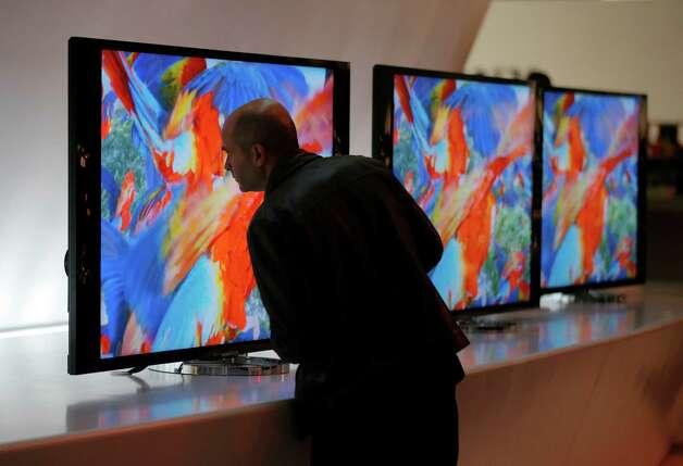 A man looks at the back of Sony's 4K XBR LED televisions at the Sony booth during a news conference at the International Consumer Electronics Show in Las Vegas, Monday, Jan. 7, 2013. The 2013 International CES gadget show, the biggest trade show in the Americas, is taking place in Las Vegas this week. (AP Photo/Jae C. Hong) Photo: Jae C. Hong, Associated Press / AP