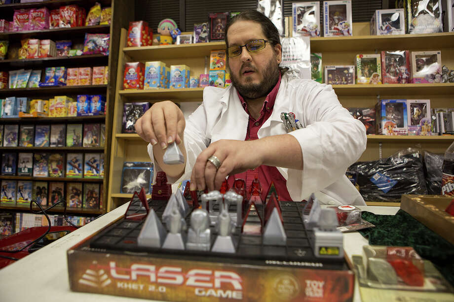 Mycol Hritz, president of the Alamo Network of Khet Hobbyists, says the board game Khet is as easy to learn as checkers. Photo: Michael Miller, For The Express-News / San Antonio Express-News