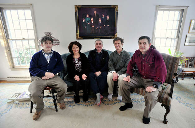 Annie Orr's children, from left, Matthew, Elizabeth, Bill, James and Jonathan sit beneath a family portrait in their mother's living room in Danbury. Photographed on Tuesday, Jan. 8, 2013. Annie, a prominent Danbury social activist, died Monday. Photo: Jason Rearick / The News-Times