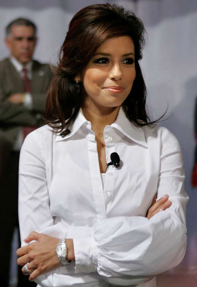 Eva Longoria waits to announce Democratic presidential hopeful, Sen. Hillary Rodham Clinton, D-N.Y, at a campaign stop at the Austin Convention Center for a town hall  in Austin, Texas, Monday, March 3, 2008. Photo: Carolyn Kaster, AP / AP