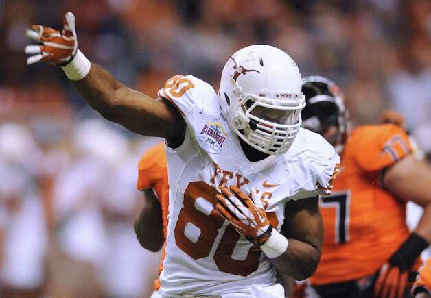 Texas defensive end Alex Okafor celebrates after the Texas defense stopped Oregon State on a drive during Valero Alamo Bowl action in the Alamodome on Saturday, Dec. 29, 2012. Photo: Billy Calzada, San Antonio Express-News / SAN ANTONIO EXPRESS-NEWS