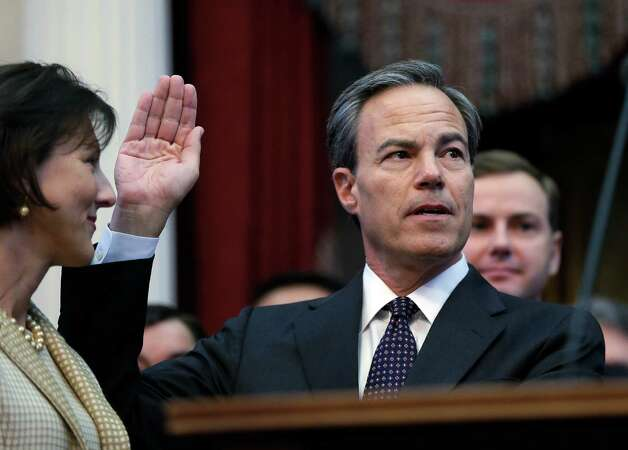 Rep. Joe Straus, right, R-San Antonio, with his wife Julie, left, is sworn in as speaker of the house by Chief Justice Wallace Jefferson, right, during the opening session of the 83rd Texas Legislature, Tuesday, Jan. 8, 2013, in Austin, Texas. (AP Photo/Eric Gay) Photo: Eric Gay, Associated Press / AP
