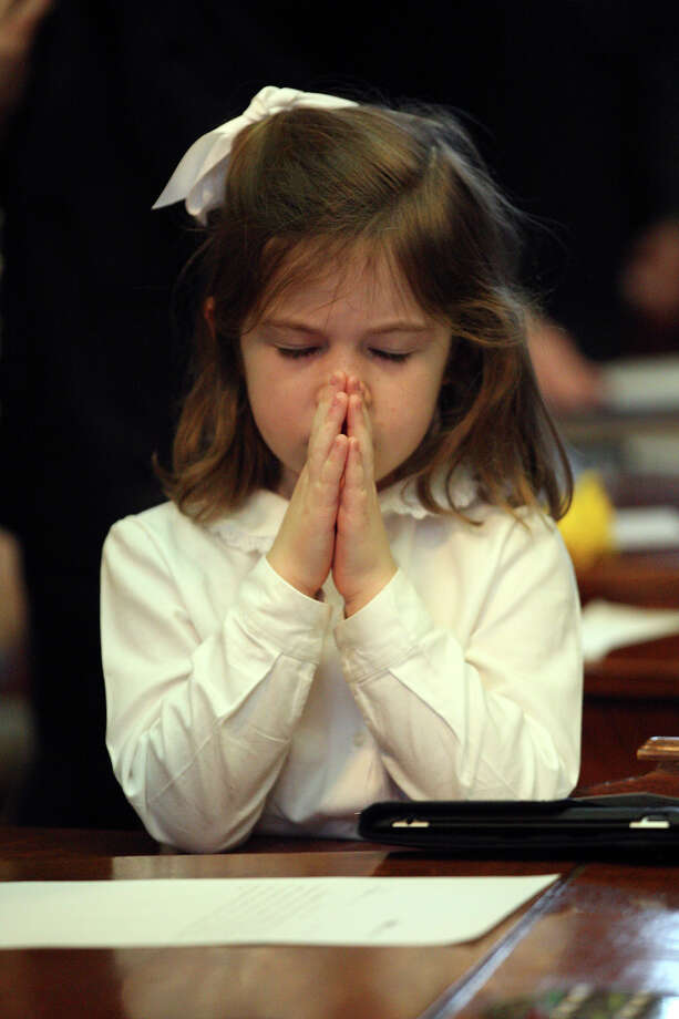 Helen Taylor, 6, daughter of Rep. Van Tylor, R-Plano, prays during the invocation at the start of the 83rd Texas Legislature at the State Capitol in Austin, Tuesday, Jan. 8, 2013. Photo: Jerry Lara, San Antonio Express-News / © 2013 San Antonio Express-News