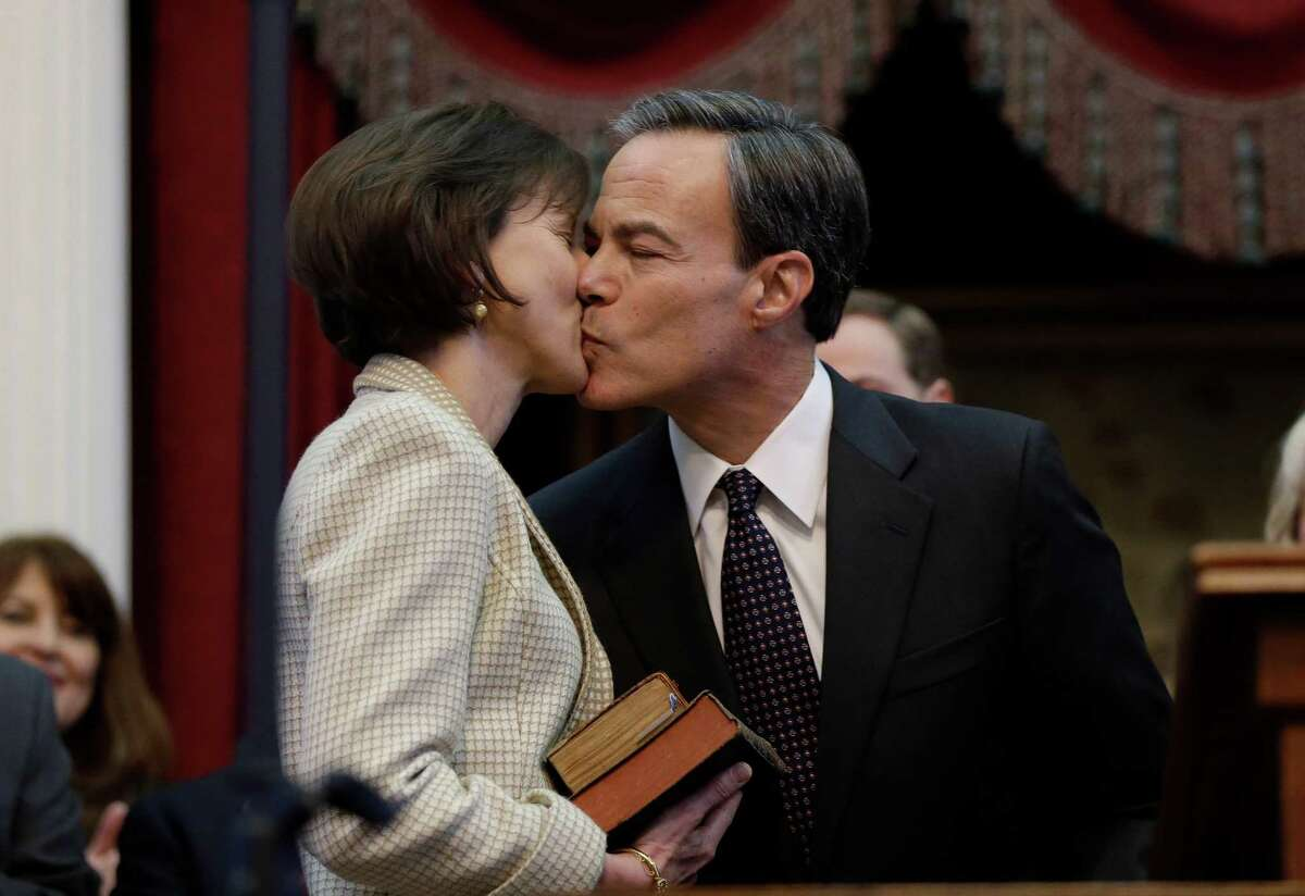 Rep. Joe Straus, right, R-San Antonio, kisses his wife Julie, left, after he was sworn in as speaker of the house by Chief Justice Wallace Jefferson during the opening session of the 83rd Texas Legislature, Tuesday, Jan. 8, 2013, in Austin, Texas. (AP Photo/Eric Gay)