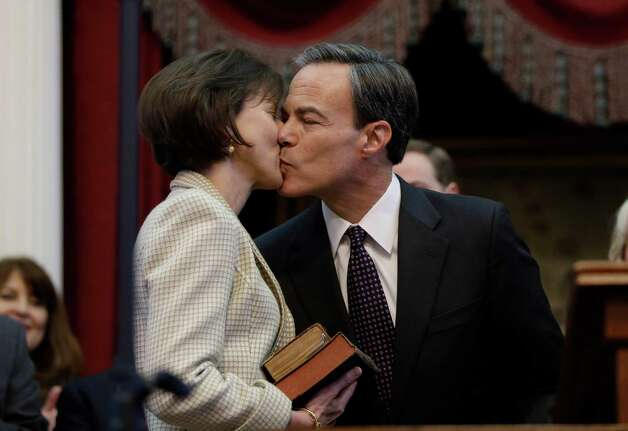 Rep. Joe Straus, right, R-San Antonio, kisses his wife Julie, left, after he was sworn in as speaker of the house by Chief Justice Wallace Jefferson during the opening session of the 83rd Texas Legislature, Tuesday, Jan. 8, 2013, in Austin, Texas. (AP Photo/Eric Gay) Photo: Eric Gay, Associated Press / AP