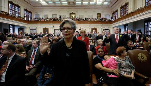 Rep. Senfronia Thompson, center, D-Houston, takes the oath with fellow representatives during the opening session of the 83rd Texas Legislature, Tuesday, Jan. 8, 2013, in Austin, Texas. (AP Photo/Eric Gay) Photo: Eric Gay, Associated Press / AP