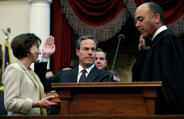 Rep. Joe Straus, center, R-San Antonio, with his wife Julie, left, is sworn in as speaker of the house by Chief Justice Wallace Jefferson, right, during the opening session of the 83rd Texas Legislature, Tuesday, Jan. 8, 2013, in Austin, Texas. (AP Photo/Eric Gay) Photo: Eric Gay, Associated Press / AP