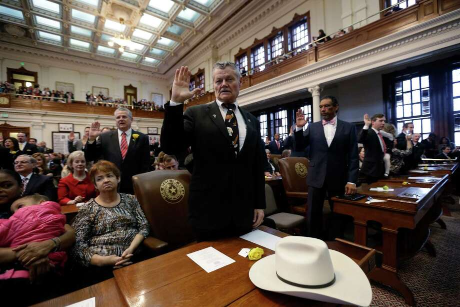 """Rep. Charles """"Doc"""" Anderson, center, R-Waco, takes the oath with fellow representatives during the opening session of the 83rd Texas Legislature, Tuesday, Jan. 8, 2013, in Austin, Texas. (AP Photo/Eric Gay) Photo: Eric Gay, Associated Press / AP"""