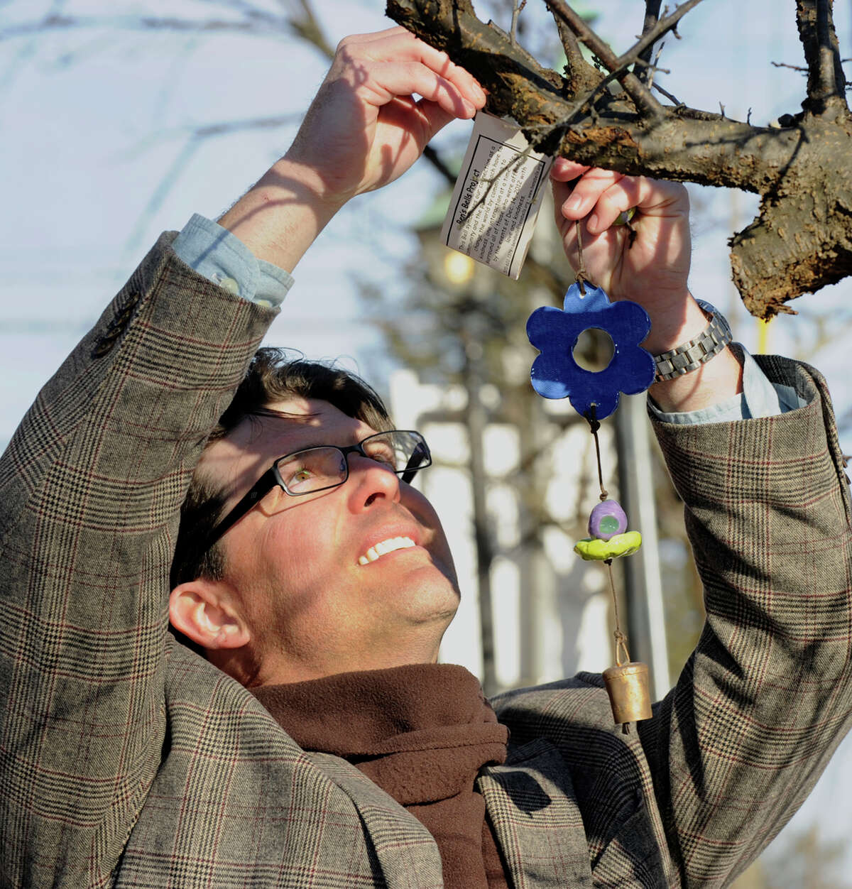Jason Ott, is part of a group from Tucson, Arizona who, with the help of local volunteers, hung over 1000 ceramic bells around Newtown, in memory of the Sandy Hook victims, Tuesday, Jan. 8, 2012.