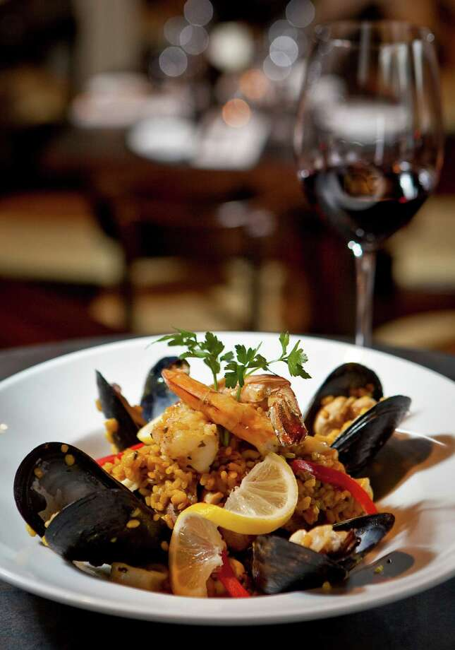 Don't miss the paella at Costa Brava Bistro. Photo: Nick De La Torre, Staff / © 2013  Houston Chronicle
