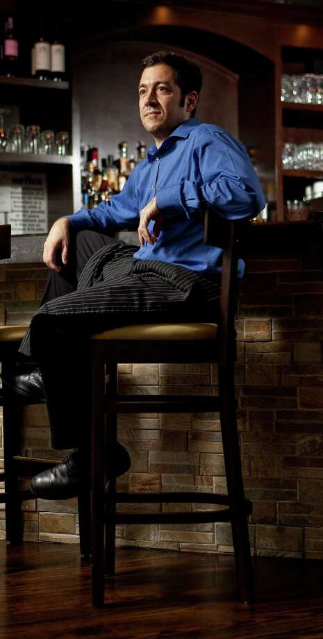 Cristian Lopez tends the quaint bar at Costa Brava Bistro. Photo: Nick De La Torre, Staff / © 2013  Houston Chronicle