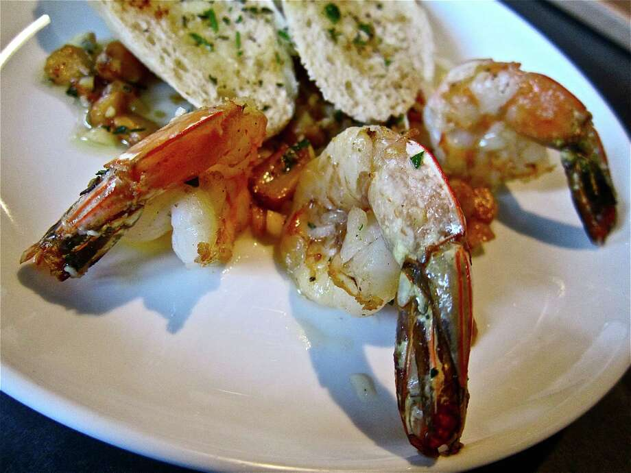 Gambas al ajillo (shrimp with roasted garlic) at Costa Brava Bistro. Photo: Photo By Alison Cook