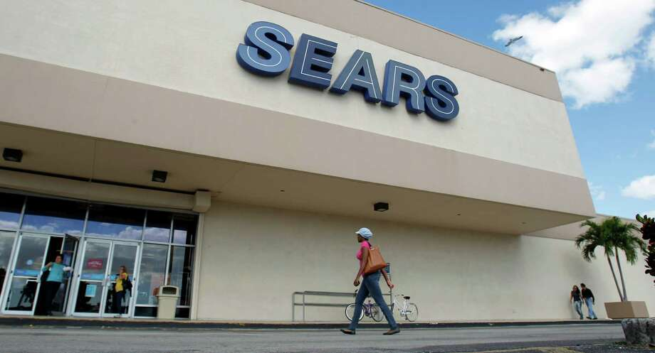 In this Friday, Nov. 9, 2012, photo, a Sears store is shown in Hialeah, Fla. Shares of Sears Holdings fell Tuesday, Jan. 8, 2013, a day after the retailer announced that chairman and hedge fund billionaire Edward Lampert will take over the role of CEO. The investor queasiness came even as the Hoffman Estates, Ill.-based company offered an update on holiday sales that showed some improvements at its Sears stores. Overall, the company still faces a long, uphill battle to turn itself around. (AP Photo/Alan Diaz) Photo: Alan Diaz