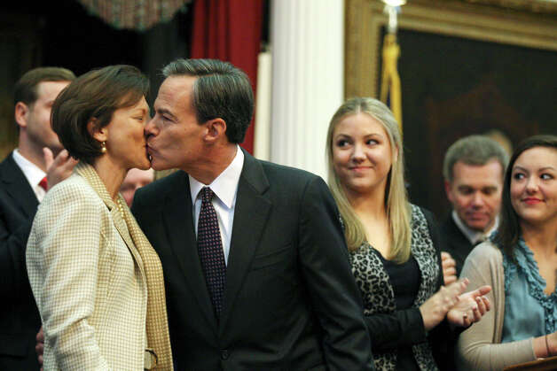 Speaker of the House Joe Straus kisses his wife, Julie, after he was sworn in as speaker after the 83rd Texas Legislature convened at the State Capitol in Austin, Tuesday, Jan. 8, 2013. With them are their daughters, Robyn, right and Sara Straus. Photo: Jerry Lara, San Antonio Express-News / © 2013 San Antonio Express-News