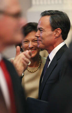 Representative Joe Straus smiles after he is elected Texas Speaker of the House of Representatives during the 83rd Texas Legislature at the State Capitol in Austin, Tuesday, Jan. 8, 2013. In back is his wife, Julie. Photo: Jerry Lara, San Antonio Express-News / © 2013 San Antonio Express-News