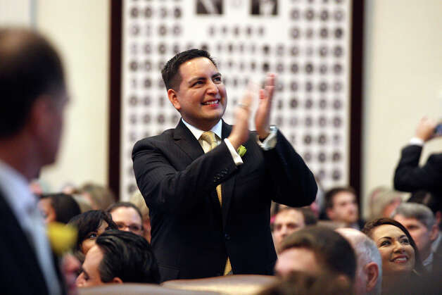 State Rep. Phillip Cortez, D-San Antonio, acknowledges supporters after he and the rest of the representatives were sworn in at the start of the 83rd Texas Legislature at the State Capitol in Austin, Tuesday, Jan. 8, 2013. Photo: Jerry Lara, San Antonio Express-News / © 2013 San Antonio Express-News