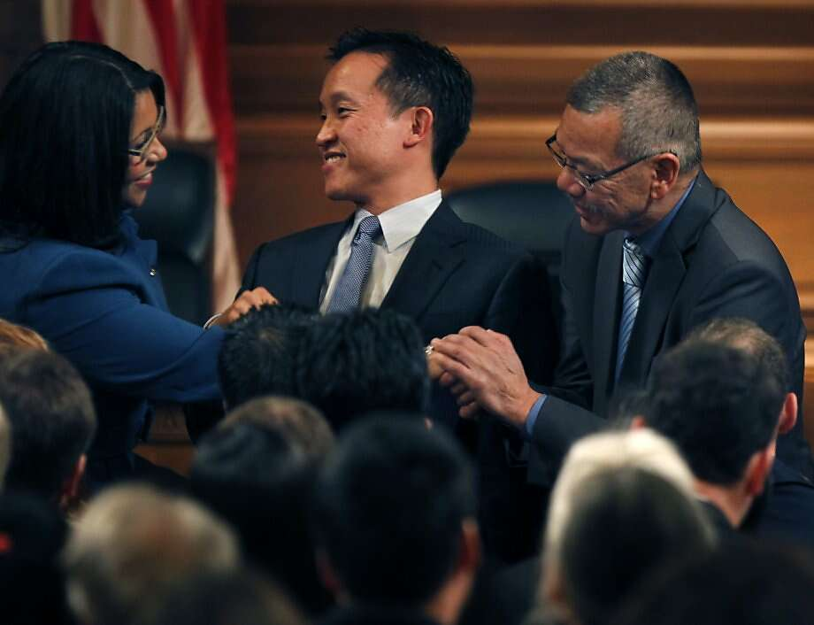 Mutual congratulations are exchanged after their swearing-in by new supervisors London Breed (left) and Norman Yee (right). David Chiu (center) was re-elected president of the board after he was sworn in for another term as supervisor. Photo: Paul Chinn, The Chronicle