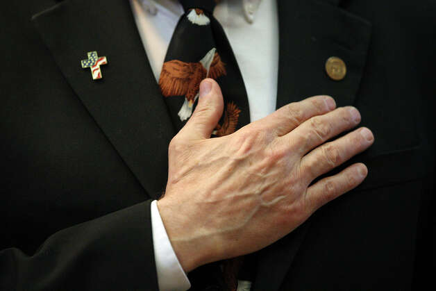 "Rep. Charles ""Doc"" Anderson, D-Waco, places his hand over his heart during the Pledge of Allegiance at the start of the 83rd Texas Legislature at the State Capitol in Austin, Tuesday, Jan. 8, 2013. Photo: Jerry Lara, San Antonio Express-News / © 2013 San Antonio Express-News"
