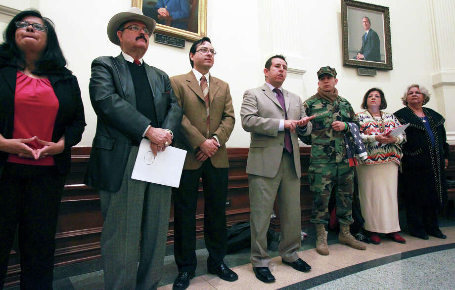 Luis Figueroa (center), who is a legislative attorney for MALDEF, speaks at a small rally in the rotunda area during the opening of the 83rd Texas Legislature at the State Capitol in Austin, Tuesday, Jan. 8, 2013. Photo: Tom Reel, San Antonio Express-News / ©2012 San Antono Express-News
