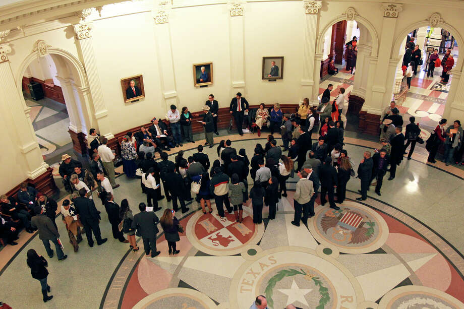 A small rally proceeds in the rotunda area during the opening of the 83rd Texas Legislature at the State Capitol in Austin, Tuesday, Jan. 8, 2013. Photo: Tom Reel, San Antonio Express-News / ©2012 San Antono Express-News