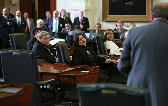 State Senator Leticia Van De Putte thanks Senator Juan Hinojosa for praise before she  gives her farewell speech on the Senate floor Tuesday,  February 24, 2015 Photo: Tom Reel, San Antonio Express-News