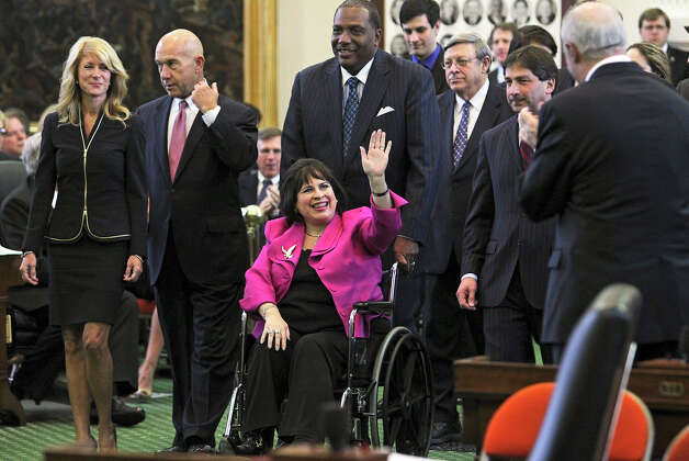 Senator leticia Van de Putte is brought down the center aisle of the Senate to be sworn in as Senate Pro Tem during the opening of the83rd Texas Legislature session, Tuesday, Jan. 8, 2013, in Austin, Texas. Photo: Tom Reel, San Antonio Express-News / ©2012 San Antono Express-News