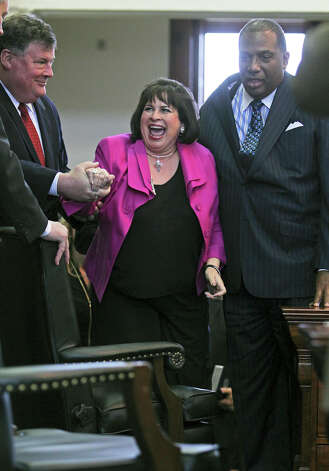 Senator Leticia Van de Putte is helped to the podium to be sworn in as as president pro tempore of the Texas Senate during the opening of the 83rd Texas Legislature, Tuesday, Jan. 8, 2013, in Austin. Photo: Tom Reel, San Antonio Express-News / ©2012 San Antono Express-News