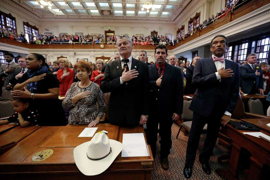 "Rep. Charles ""Doc"" Anderson, center, R-Waco, and Rep. Joe Deshotel, D-Port Arthur, right, join with fellow representatives and family members for the Pledge of Allegiance during the opening session of the 83rd Texas Legislature, Tuesday, Jan. 8, 2013, in Austin, Texas. (AP Photo/Eric Gay) Photo: Eric Gay, Associated Press / AP"