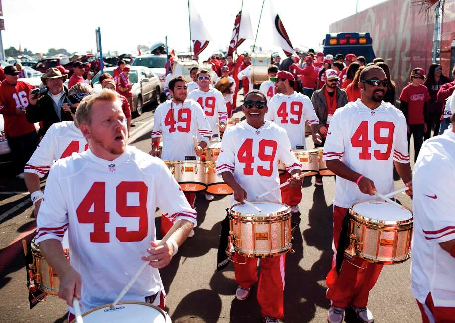 Keelan Tobia, center, leads the Niner Noise around Candlestick as they pep up the crowd before the game. Keelan, 21, is the reigning world champion snare drum soloist. The Modesto-native joined the line in 2007 as a sophomore in high school. Photo: Jason Henry, Special To The Chronicle / ONLINE_YES