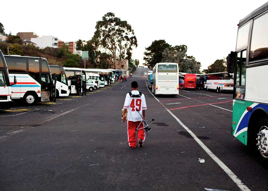 Keelan Tobia makes his way out of Candlestick Park towards the bus to pack up and head back home. After an almost 10-hour day, Keelan and his drum line are still in good spirits, because they love what they do. Photo: Jason Henry, Special To The Chronicle / ONLINE_YES