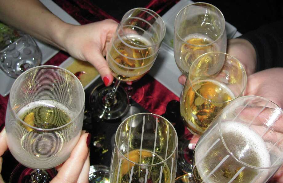 A champagne toast can be a festive component to a party. Photo: Contributed