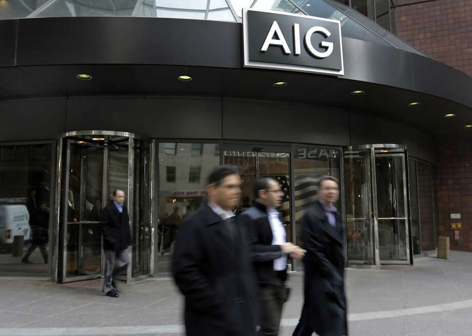 People pass the AIG building, in New York,  Tuesday, Jan. 8, 2013. (AP Photo/Richard Drew) STANDALONE PHOTO Photo: Richard Drew, Associated Press