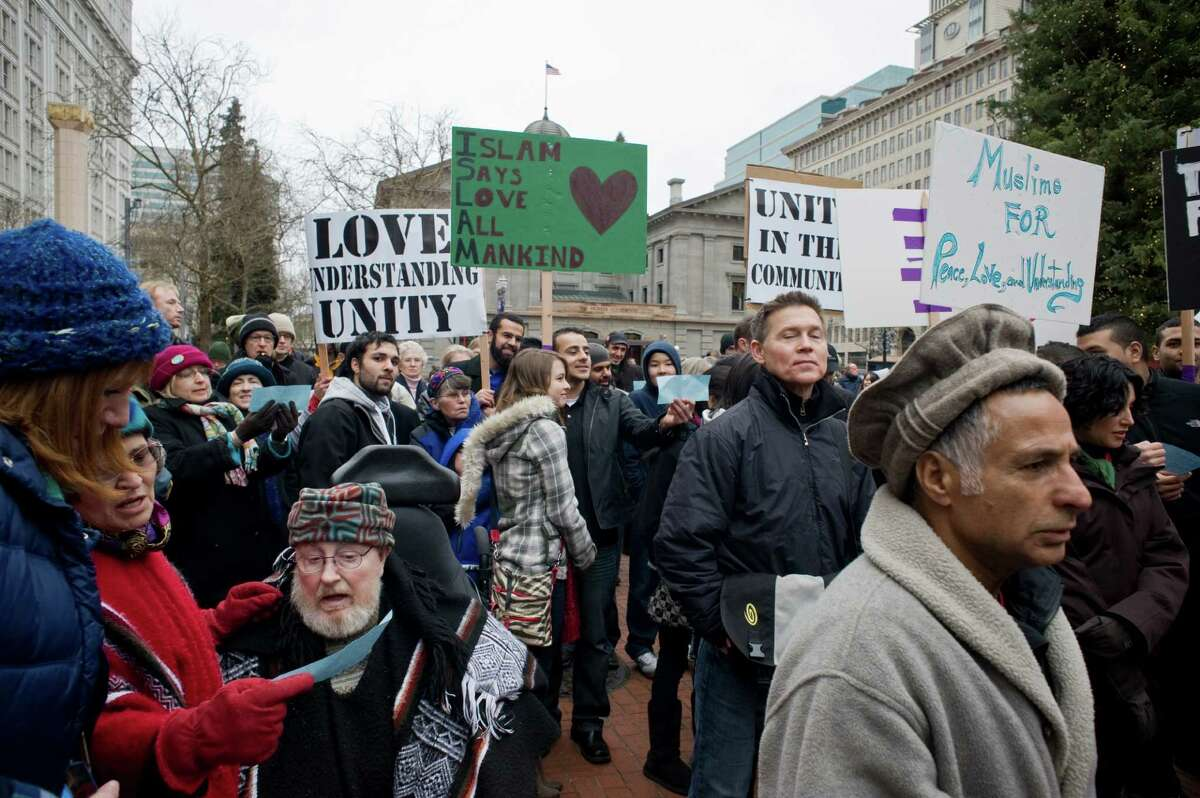 Muslims and non-Muslims join a rally in Portland, Ore., last month to show solidarity and to condemn acts of terrorism and violence. Hate crimes against Muslims merit tough law enforcement.