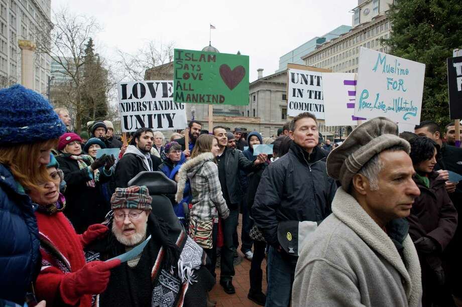 Muslims and non-Muslims join a rally in Portland, Ore., last month to show solidarity and to condemn acts of terrorism and violence. Hate crimes against Muslims merit tough law enforcement. Photo: Torsten Kjellstrand, Associated Press / The Oregonian
