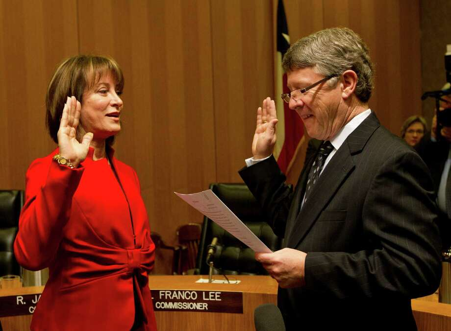 Janiece Longoria is sworn in by Judge Ed Emmett as the chair of the Port of Houston at the Harris County Commissioner's Court where the Commissioner's Court and the City Council met jointly to vote for the chair of the Port Commission, Tuesday, Jan. 8, 2013, in Houston. Photo: Karen Warren, Houston Chronicle / © 2013 Houston Chronicle
