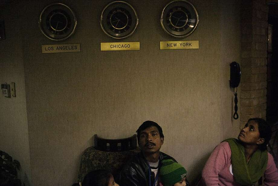 12/9/2009: Susil Ghalley, 42, and his family, just arrived in the USA, at Newark's refugee hotel. Photo: Gabriele Stabile