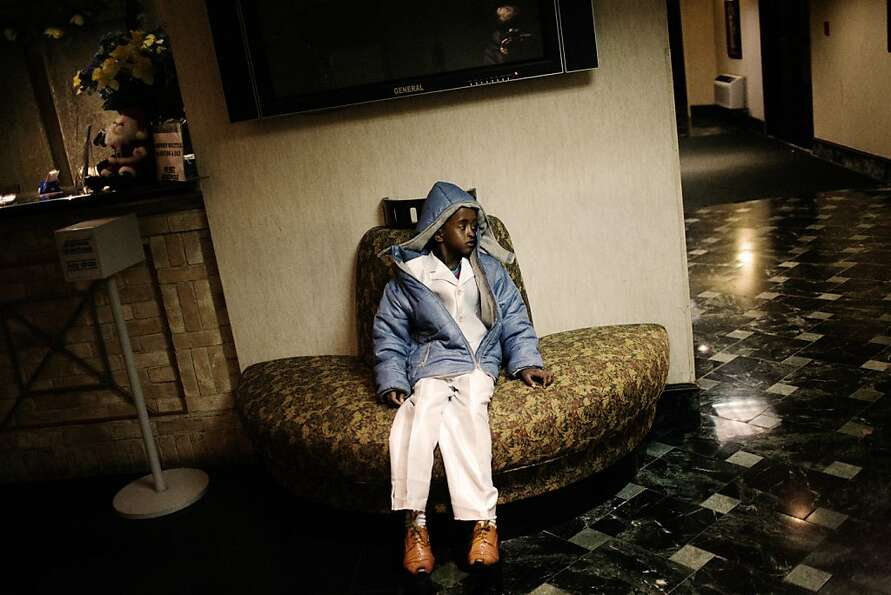 12/11/2009, Newark, New Jersey: A somali boy waits in the lobby of the