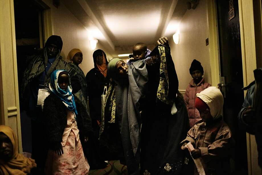 12/11/2009: Somali refugees, despite the care provided by the IOM personnel, decided to spend the night in the hallway of the hotel, some of them afraid to be left behind, in their trip to their resettlement destination. Photo: Gabriele Stabile