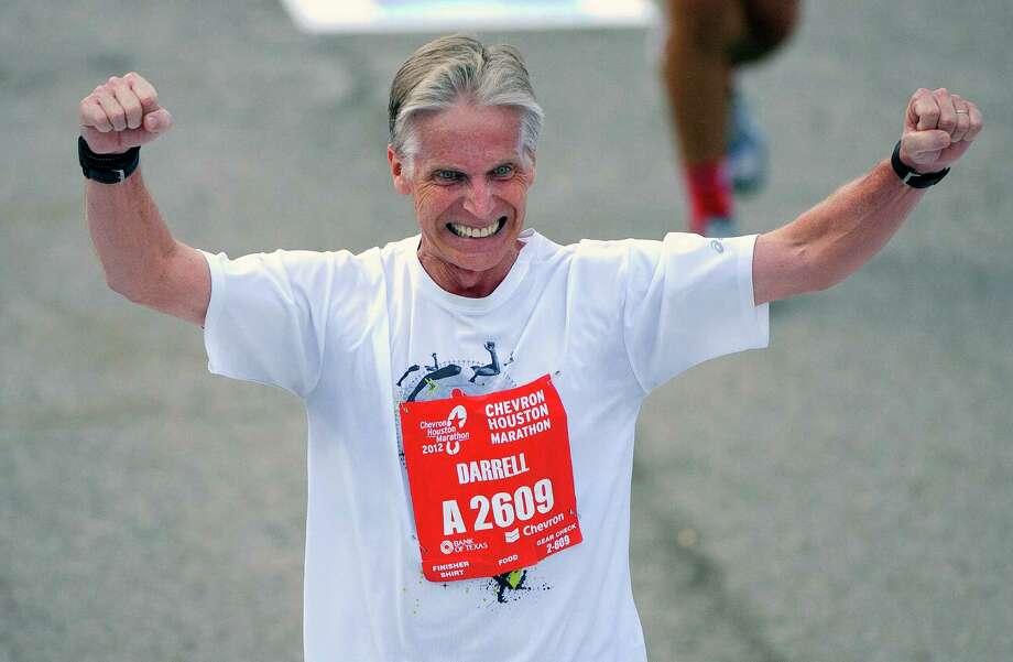 Darrell Yarbrough celebrates while crossing the finish line during the Chevron Houston Marathon Sunday, Jan. 15, 2012, in Houston. (Cody Duty / Houston Chronicle) Photo: Cody Duty, Staff / © 2011 Houston Chronicle