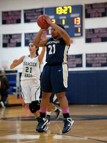 King School's Tatiana Brown takes a jump shot during Tuesday's loss to Hamden Hall. Brown scored the 1,000th point of her career Tuesday. Photo: Contributed Photo, Kathlleen O'Rourke/King School/C / Stamford Advocate Contributed