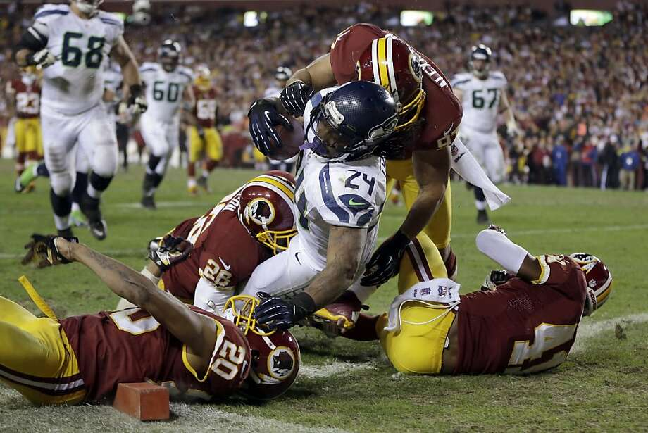 Seahawks running back Marshawn Lynch tumbles in the end zone for a touchdown during the second half of Sunday's wild-card win over the Redskins. He ran for 132 yards on 20 carries in the game. Photo: Matt Slocum, Associated Press
