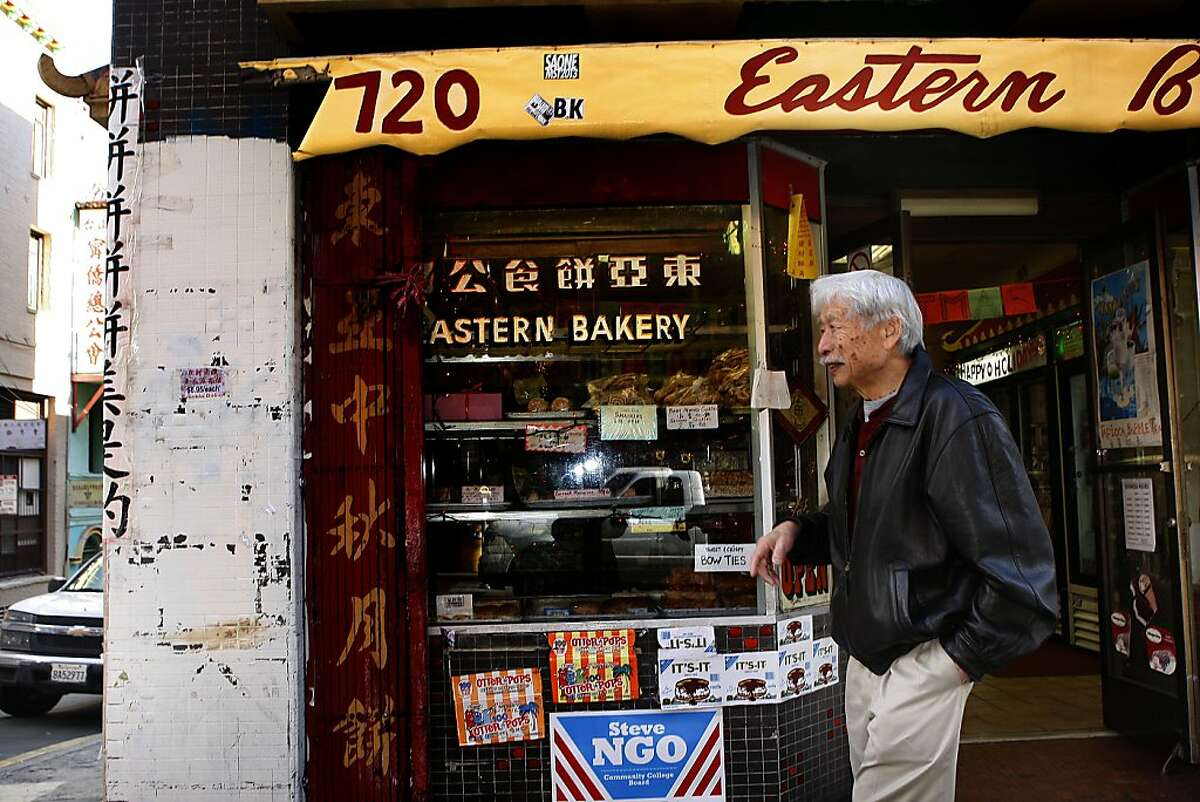 Philip Choy walks past the Eastern Bakery in San Francisco's Chinatown last month. He has written a new book on the neighborhood, focusing on history instead of tourism.