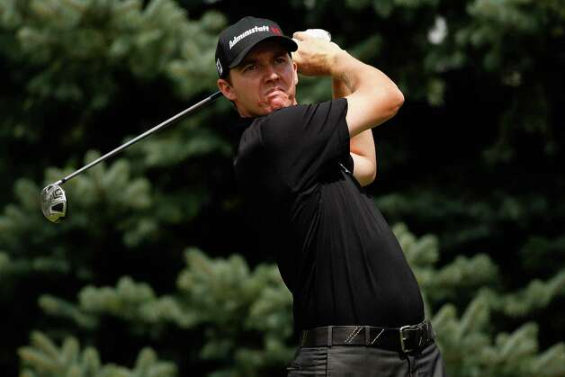 Jimmy Walker tees off on the second hole during round three of the Buick Open at Warwick Hills Golf and Country Club on Aug. 1, 2009 in Grand Blanc, Mich. Photo: Chris Graythen, Getty Images / 2009 Getty Images
