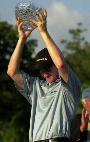 Jimmy Walker holds up the trophy after winning the Nationwide Panama Championship at Panama Golf Club in Panama City, Panama on Sunday, Feb. 8, 2004. Photo: Arnulfo Franco, Associated Press / AP