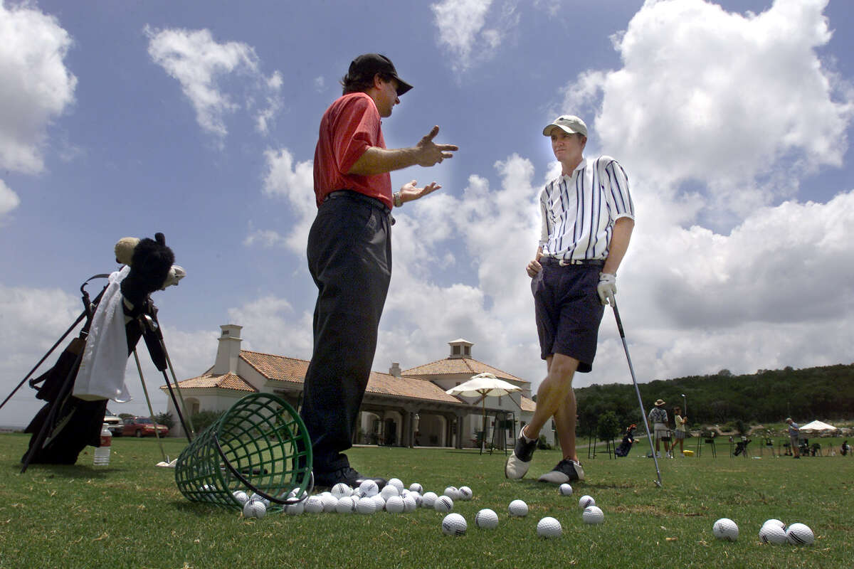 La Cantera Golf Academy pro Bryan Gathright (left) and Baylor University golfer Jimmy Walker discuss swing technique during a lesson on June 21, 2000. Walker had injured his left shoulder about two years ago and has since been working on returning to winning form.