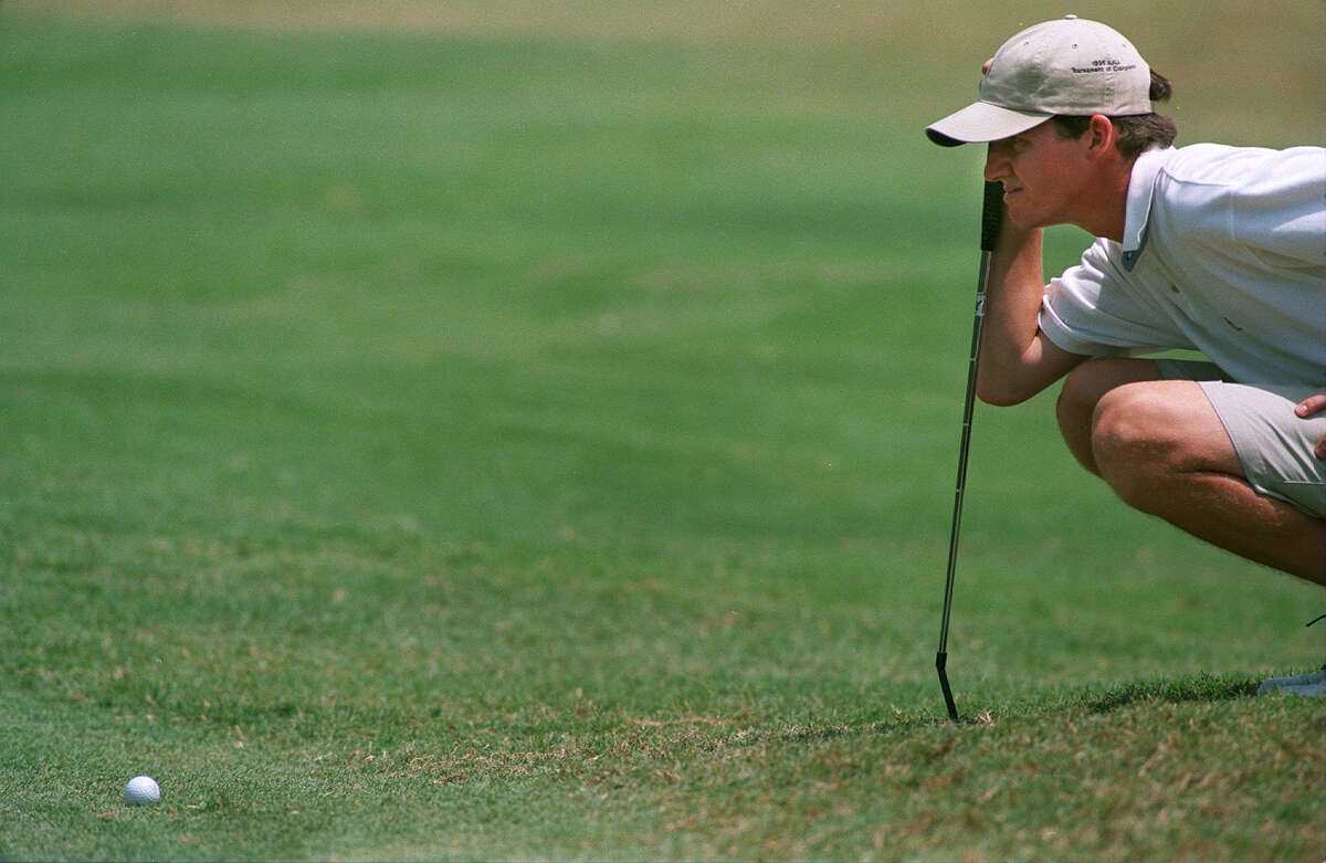 Jimmy Walker lines up his putt as he plays the U.S. Amateur qualifier at Pecan Valley Golf Course on Aug. 3, 1998.