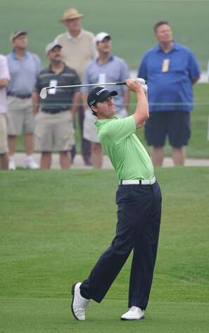 Jimmy Walker watches his second shot on 1st hole during the second round of the Houston Open PGA Tour golf tournament, Friday, April 1, 2011, in Humble. Photo: Dave Einsel, Associated Press / FR43584 AP